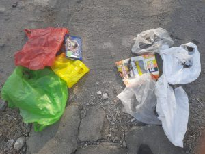 Coloured plastic bags separated for recycling